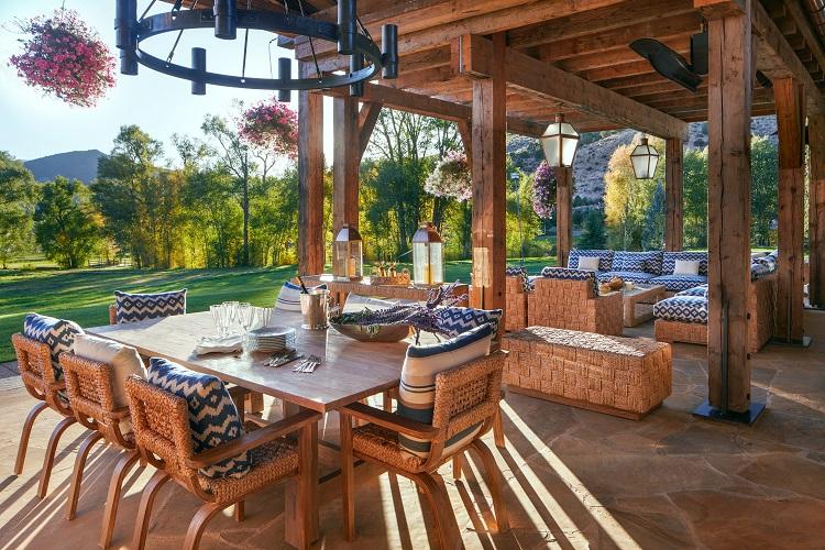 outdoor entertaining area of a luxury aspen ranch in colorado